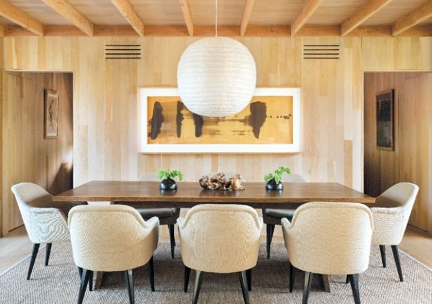 A paper and bamboo #Noguchi ceiling lamp hangs above a hand-crafted Central Station Interiors Trapeze table from ABC Carpet & Home | Fifty Shades of Geige | Hamptons Cottages & Gardens December 2013