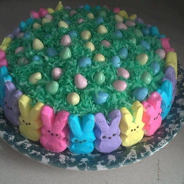 EASTER CAKE Bake your favorite cake (double layer) as directed, frost w/ your choice of frosting, cover the top w/ coconut that you dyed w/ green food coloring, place marshmallow bunnies all around,place malted milk Robin eggs on top !! To Cute
