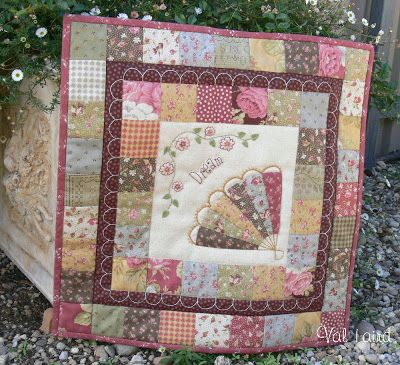 Fantasia wall-hanging uses beautiful fabrics to surround the centre square with its beautiful appliqued fan. Val Laird Designs