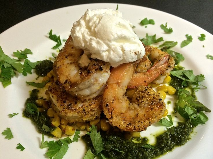 King prawns dusted with smoked polenta on roasted corn with salsa verde and goat curd.