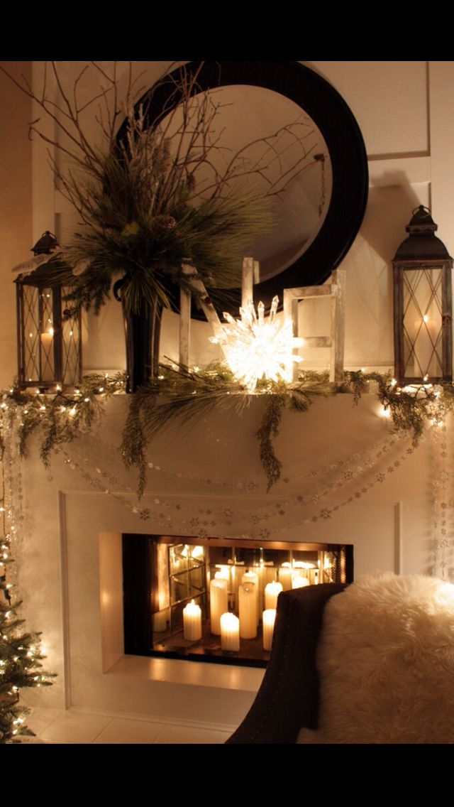 Winter White Mantel & church candles in the fire place. Idea for  framing/mantel around fireplace
