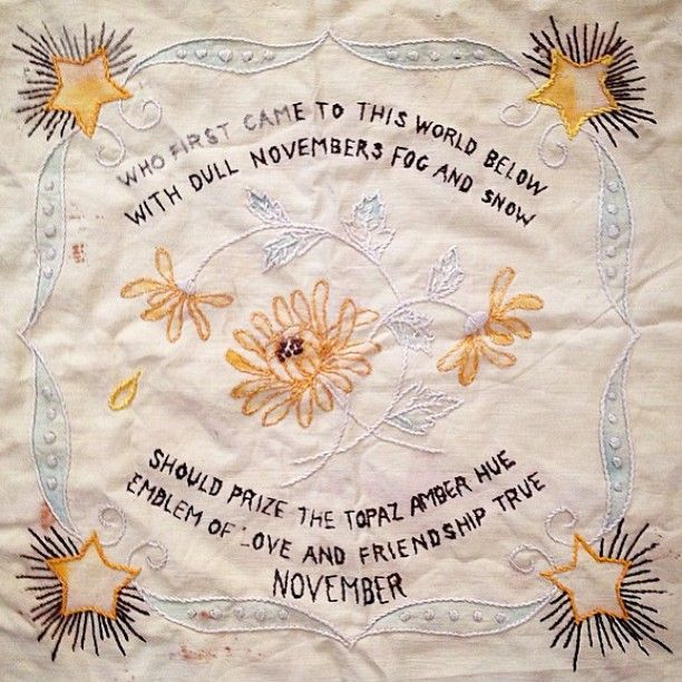 I adore this old embroidered pillow cover posted by