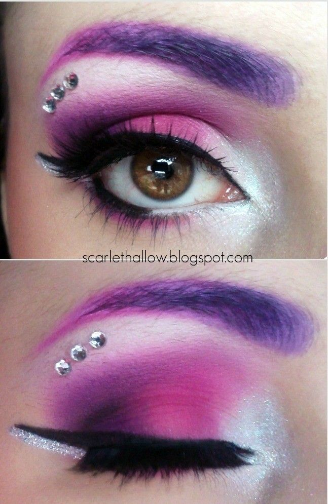 Crystals highlight a spectrum of purple and white eye shadows with a bold eye liner.
