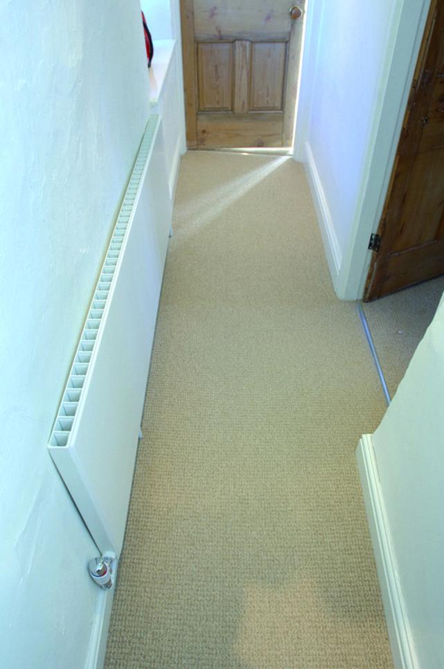 Dansk Plan radiator use in a narrow farmhouse hallway.