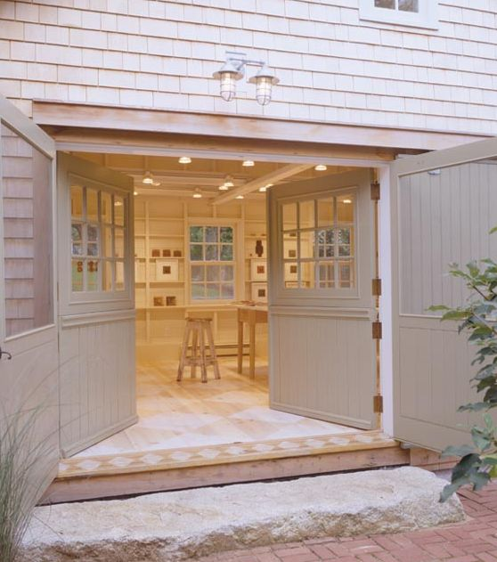 Beautiful old garage for Rob's office --  doors and overall light color scheme