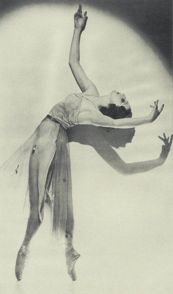 1920's dancer. The fact that her torso causes a shadow beneath her just gives it a lovely effect, there looks like there is another dancer on the stage. Her legs look powerful and strong holding her body weight but her top half looks graceful by the way her arms are positioned and the dancer's face looks calm in her own little world.