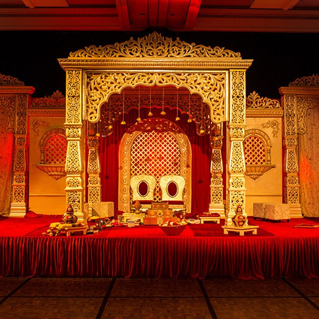The mandap is decorated as one fit for a king.