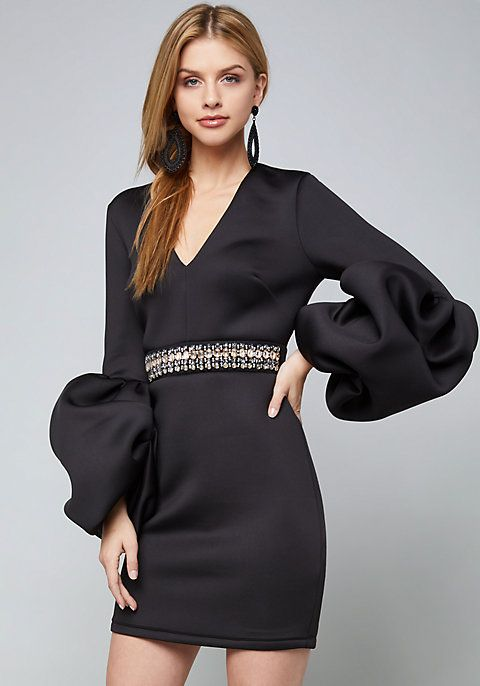 Unforgettable Little Black Dress With Dramatic Puff Sleeves And A