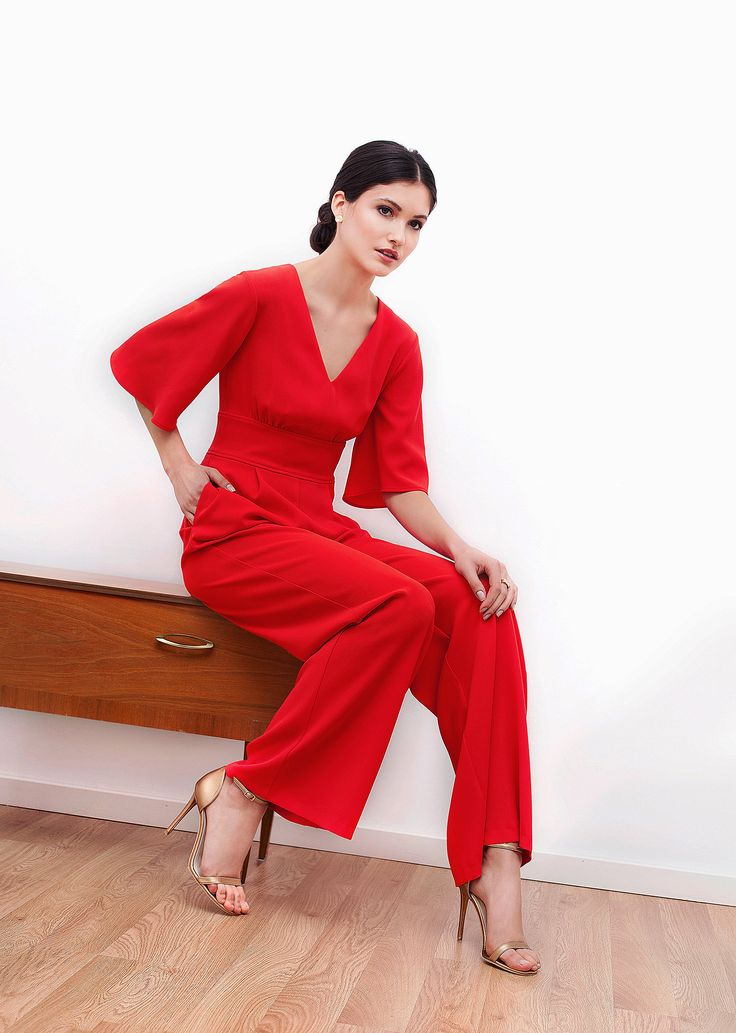 Adele jumpsuit. The long silhouette, the rich red, the volume of the sleeves and the ties at back create a strong, memorable piece. Youthful, modern, feminine and relaxed. Wear it with high heels and own the night.