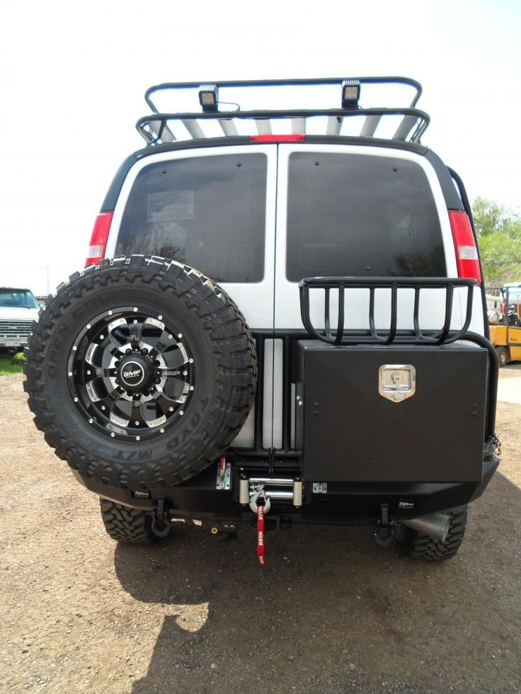 4x4_chevy_express_3500_custom_swing_out_tire_carrier_with_storage_box.