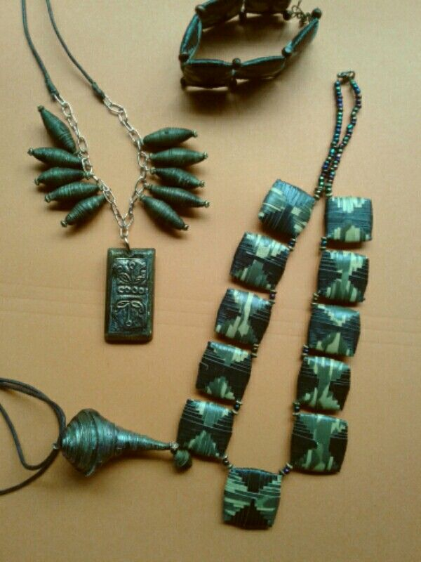 Bushbabies Craftworks : Tribal Spice series.  Woven paper beads, cocoons and coffee tin foil.