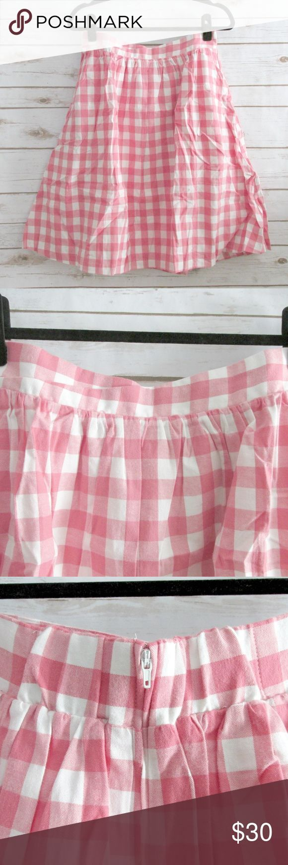 "ModCloth Pink Ivory Cotton Gingham Skirt ModCloth pink and ivory gingham skirt.  The skirt has a sweetheart look folded waist with stretch in the back.  Zip closure and fully lined. Tags are on packaging, not attached to skirt.  Condition: NWT Type: Skirt Brand: ModCloth Size: L Color: Ivory & Pink Measurements: 30"" Waist, 23.5"" Length Materials: 100% Cotton Manufacturer: China  DD0.12:201902031659:13:982M ModCloth Skirts Midi"