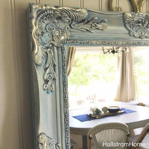This French Country Vanity Mirror has a dark grey base with a bright blue and then a light tan/ grey color with a satin nickel overlay.