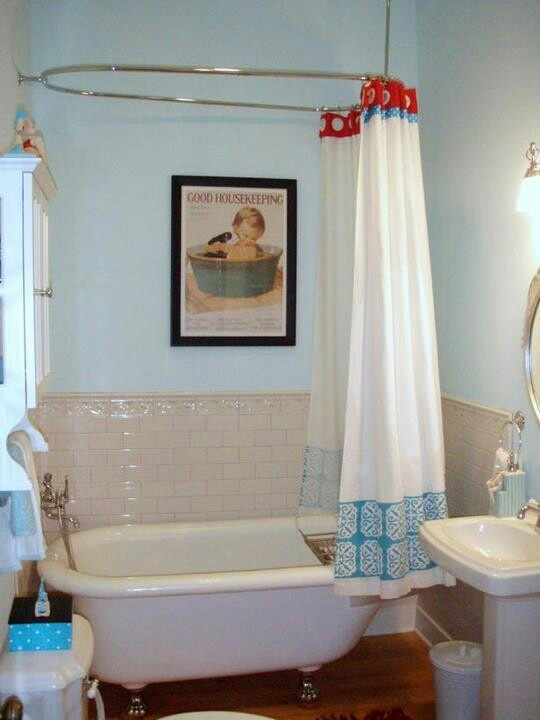 Old-fashioned claw foot tub and shower.