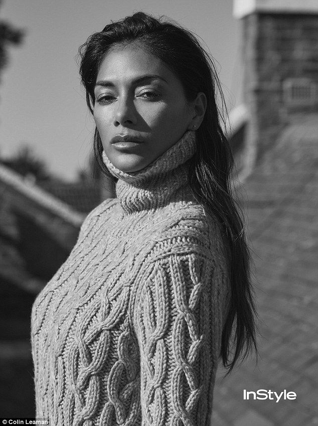 On a roll: She donned a thick cableknit roll neck jumper for another stunning shot in the shoot