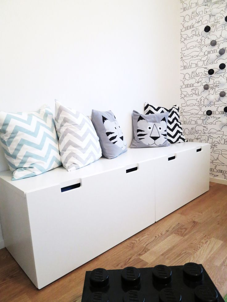Ikea Stuva toy benches with cushions, and great animal wallpaper just visible.