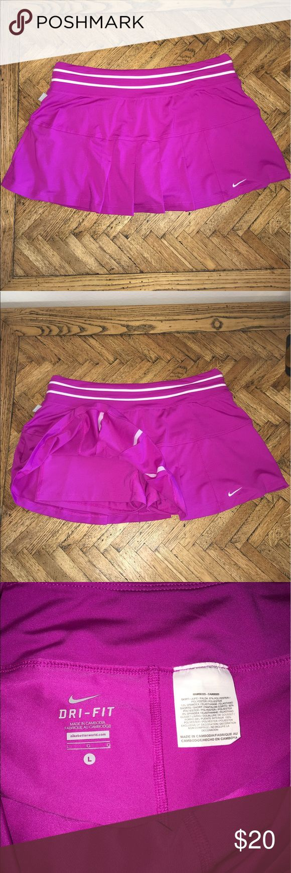 Nike Smash Classic Tennis Skirt Super cute fuchsia colored tennis skirt. It's may even be called since it has built in shorts underneath. It's in excellent condition, shows no sign of wear. Nike Skirts Mini