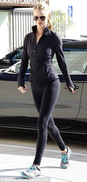 And she even stuns in her gym clothes! Rosie Huntington-Whiteley shows off her toned physique in all black... I'd so love to look like that in those clothes (or any for that matter).