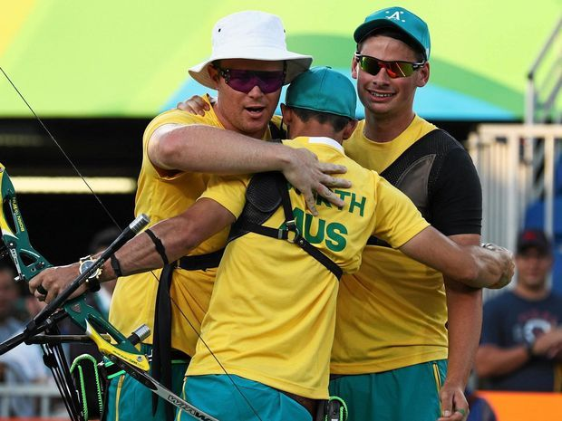 From left: Ryan Tyack, Taylor Worth and Alec Potts of Australia celebrate beating China during for the bronze medal