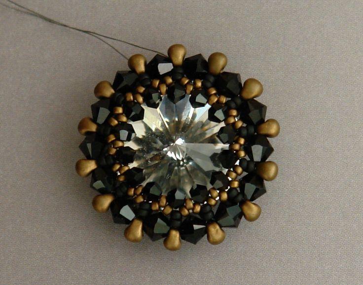 Sidonia's handmade jewelry - How to bezel an 18mm Swarovski rivoli.  ((3 and 4mm bicones, 2 colors of 15's, and 2.8mm Miyuki drops (mini fringe).)