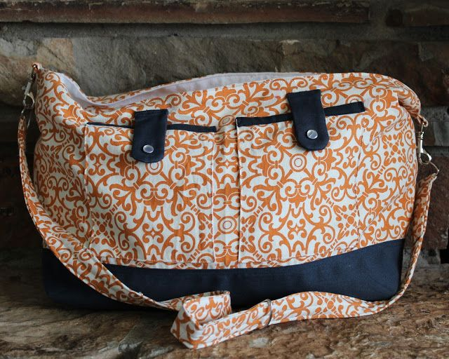 Amazing tutorial on how to make a diaper bag with every attachment you could ever want! Great diaper bag tutorial.