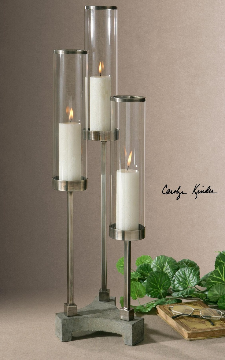 Brushed aluminum accents with clear glass globes and concrete base. Distressed beige candles included.