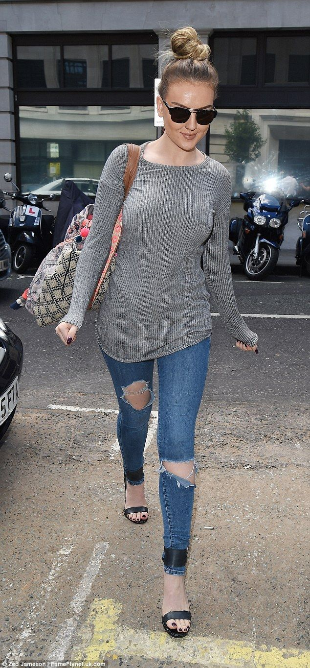 Low-key: Perrie Edwards went for a safer outfit choice in a pair of distressed skinny jean...