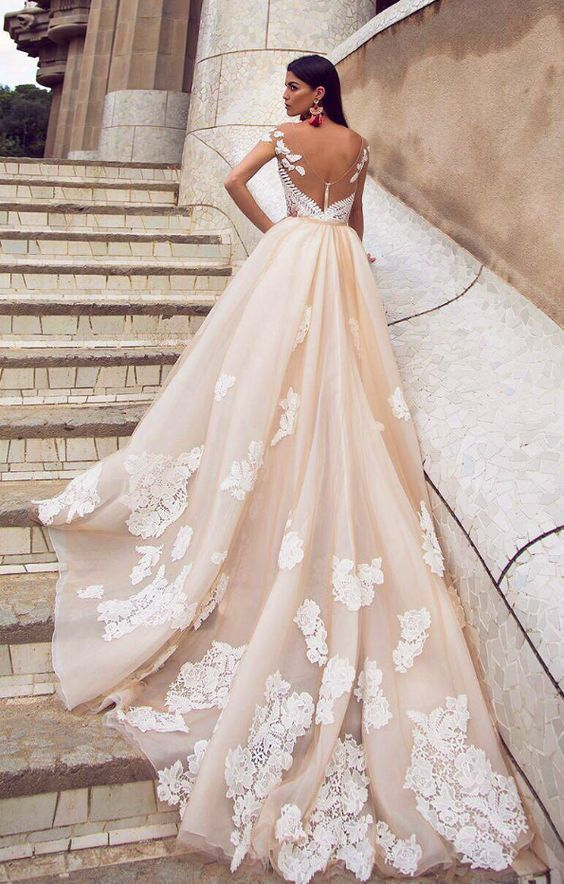 Stunning floral lace embroidered off-white wedding dress with classic bridal train; Featured Dress: Alessandra Rinaudo