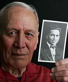 Oma Nepia, son of All Black great George Nepia, with a photo of his father