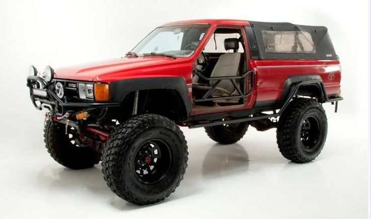 Built-Up Red 1st Gen. Toyota 4Runner with soft top.