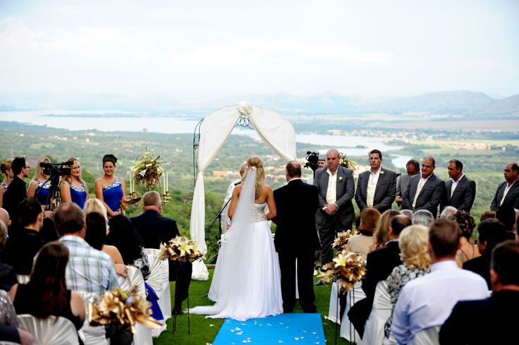 The view across Hartebeespoort Dam from Leopard Lodge is so magnificent, that very little dressing is required but the blue carpet runner and the floral arrangements added a little glamour.