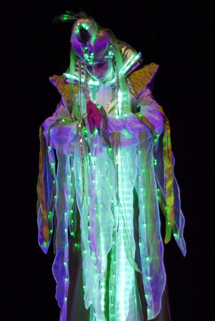 Luminous stilt costume www.streets-united.com