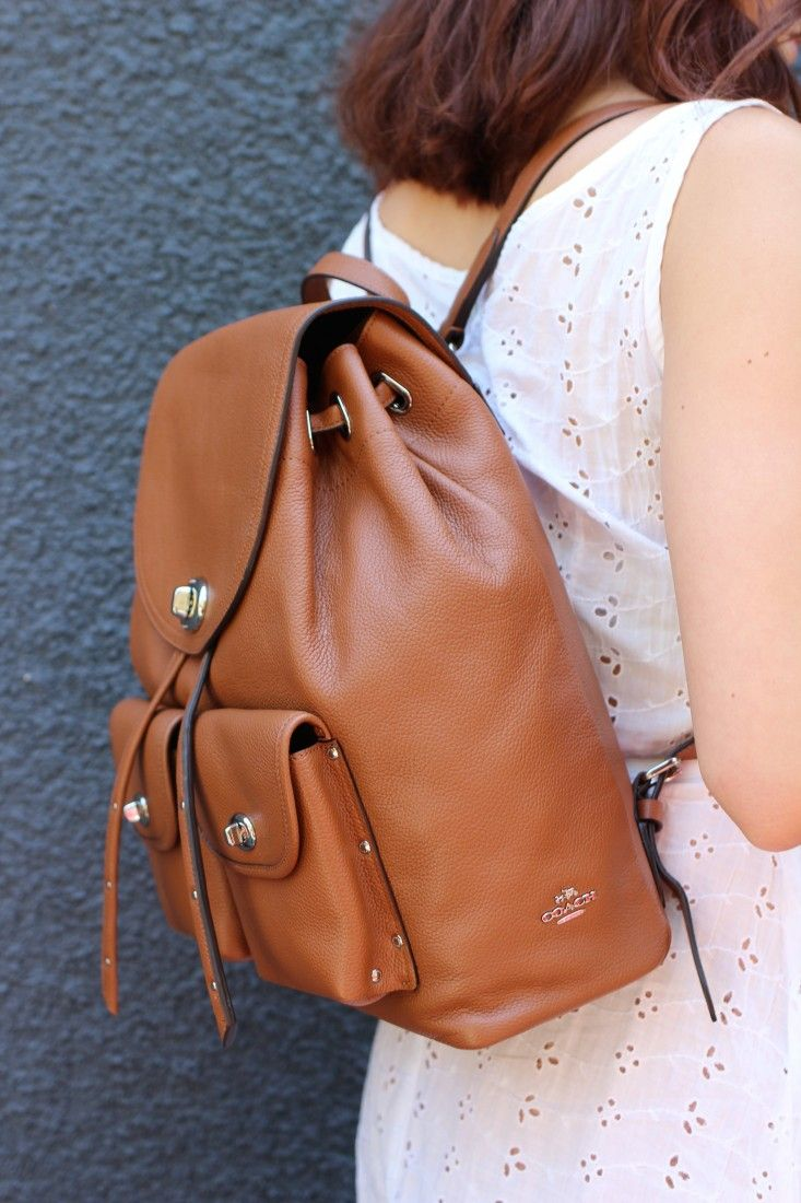 This saddle brown Coach backpack has so many subtle but beautiful details like the turnlocks on the pockets. #ad