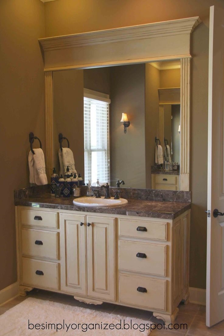 nice way to frame a bathroom mirror