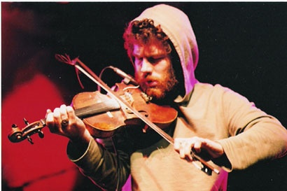 Ashley MacIsaac was born (1975) in Creignish, Nova Scotia.  He is a Canadian professional fiddler from Cape Breton Island. He has received three Juno Awards. One for Best New Solo Artist, the second for Best Instrumental Artist, and the third in 1996 for Best Roots & Traditional Album – Solo. His 1995 album Hi™ How Are You Today? was a double-Platinum selling Canadian record.    http://raincoaster.files.wordpress.com/2007/03/ashley-hoodie.jpg%3Fw%3D410%26h%3D273