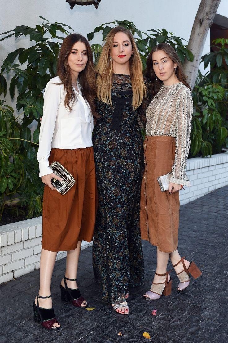 Danielle Haim in an Altuzarra top and Tome shorts, Este Haim in a Veronica Beard dress, and Alana Haim in a Tome top and Veronica Beard skirtn - October 20, 2015