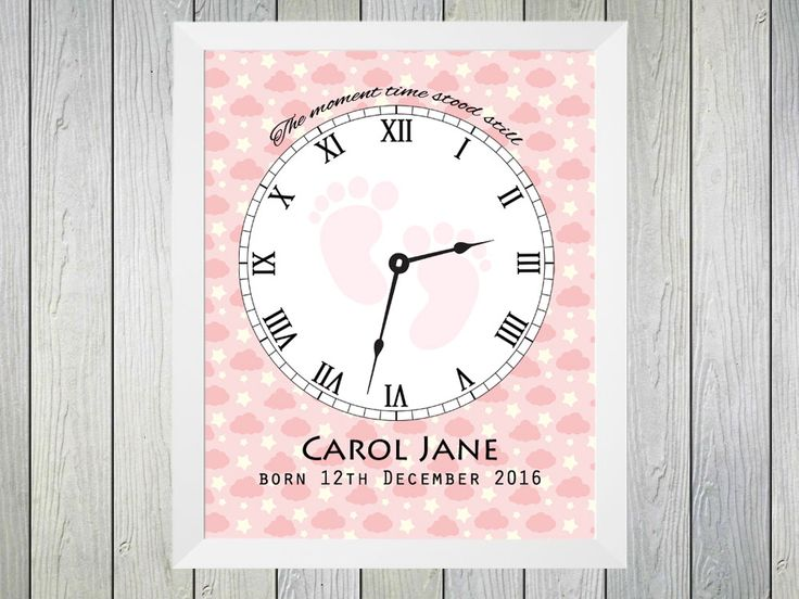 "The Moment  Time Stood Still - Framed Personalised Print to commerate the time of birth of a baby girl. Personalised with name of baby, date of birth and time of birth. Time of birth is shown on a clock with the text ""The moment time stood still""."