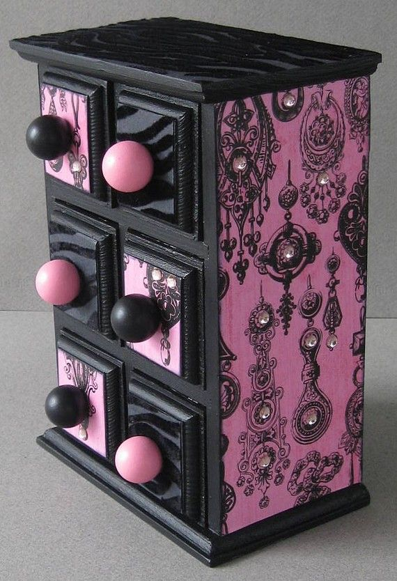 Decoupaged and hand painted inside and out this piece is just too funky and whimsical. Done in a black flocked zebra and pink and black gem print outside. Inside drawers are also finished. MEMBER - FunkyArt08