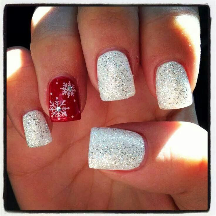 White glitter with red accent snowflake nail