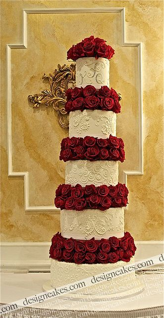 Red and white wedding cake by Design Cakes, via Flickr