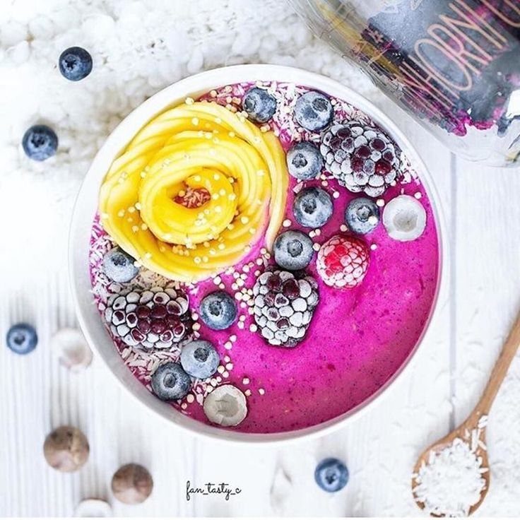 Yes I know - another smoothie :) But honestly guys who could just walk past this colorful fruity perfection begging to be made and eaten? You can access many healthy food and - more importantly :) - smoothie recipes on @fan_tasty_c s account. . I immediately fell in love with this smoothie bowl made of soaked dried pink dragon fruit topped with mango frozen berries and mini coconuts. @juliasnabl . .  LIKE  this if you agree . #regram @fan_tasty_c . It wasn't that easy making breakfast with…