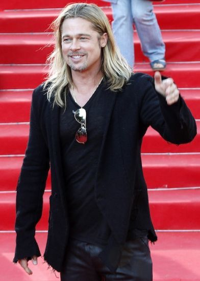 """Brad Pitt:""""Right before his breakout role in """"Thelma and Louise,"""" Brad was reportedly breaking out his killer abs alongside his fraternity brothers for girls' birthdays. His frat brother has revealed he was part of a group called """"Dancing Bares"""" in which he and six other guys would dance nude for a special lady. (Reuters)"""""""
