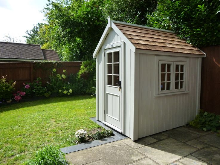This Potting Shed is finished in Pearl with a Cedar Shingle Roof