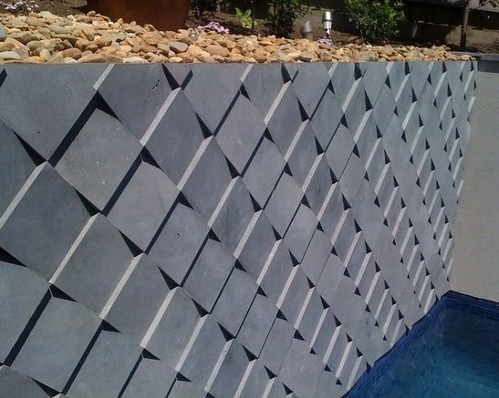 Better Exterior's Cladding - Bluestone 'fishscale' cladding on a pool wall.  This look is achieved during manufacture by tapering the thickness of the tile from one end to another.  Another great example of the endless possibilities of stone, limited only by your imagination.