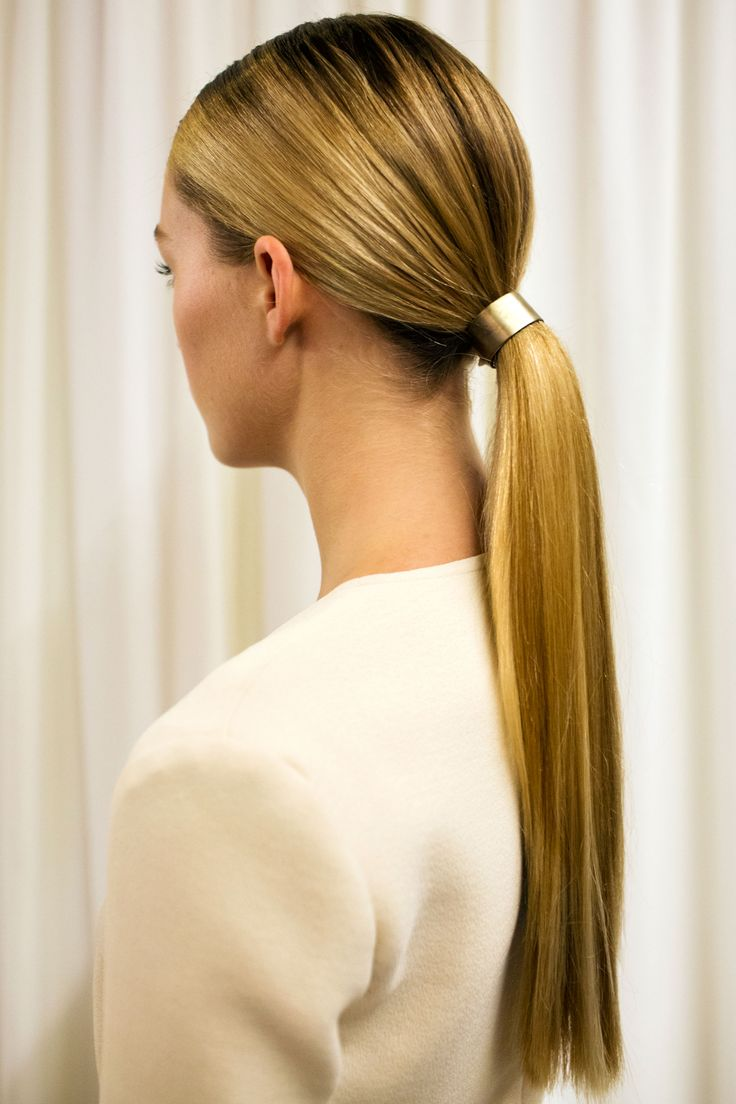 The Look: Sleek Ponytails with Hardware How-To: Hairstylist James Pecis prepped the hair with thickening mousse before straightening it, pulling it into a tight, controlled ponytail, and securing it with a silver cuff. The result was a sleek, smooth style that still felt voluminous. Backstage Essentials: Bumble and bumble Cityswept Finish, $29, bumbleandbumble.com.   - HarpersBAZAAR.com