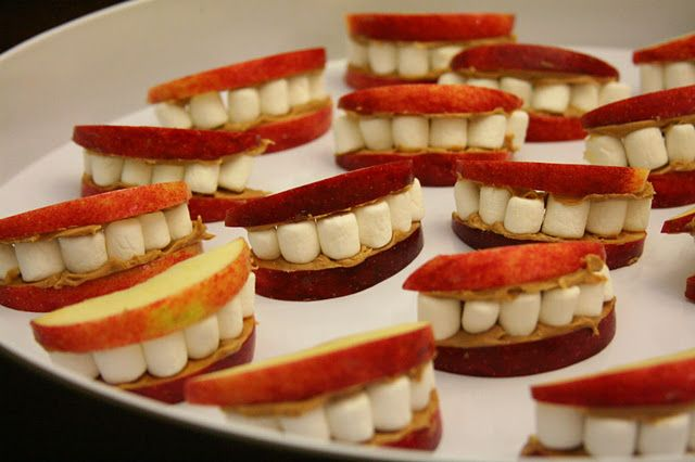 snacks apples, peanut butter,and marshmallows. Being a Dental Assistant for so many years, I love the teeth!!!