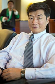 """Lobsang Sangay(1968 - ), Tibetan Prime Minister.Lobsang Sangay (Chinese: 洛桑森格་, Tibetan: བློ་བཟང་སེང་གེ་; """"kind-hearted lion""""; born 1968 in Darjeeling) is a Tibetan legal scholar and politician. He became Sikyong (equivalent to Prime Minister) of the Tibetan Government-in-Exile on 8 August 2011.born in a refugee community in Darjeeling in 1968, with a typical Shichak (settlement) background amidst fields, cows and chickens, fetching wood in the forest and helping his parents' small…"""