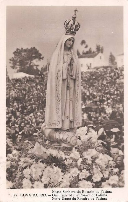 A vintage postcard of a procession in Fatima, Portugal