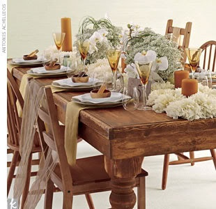 Set an eco-friendly table using certified organic baby's breath and locally grown phalaenopsis orchids arranged in sustainable bamboo containers on a bed of locally grown dahlias. Paraffin-free beeswax pillar candles; handmade glass bottles; small wood bowls made from sustainably forested acacia wood; and raw silk scarves bring the vision to life.