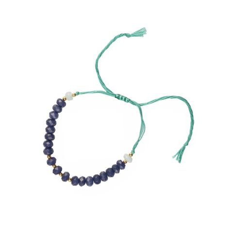 Handmade adjustable bracelets are made by quartz and special thread, to give a fine finish to your entire clothing. Coloured in Blue Jade and a turquoise tread, a calm mix of colours.
